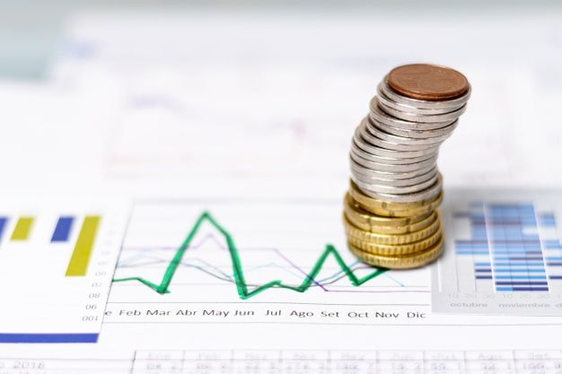 High View Pile Of Coins On Statistical Diagrams Interactive Charts Finance Small Business Lending