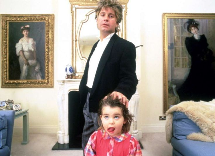 Ozzy Osbourne with daughter 1984
