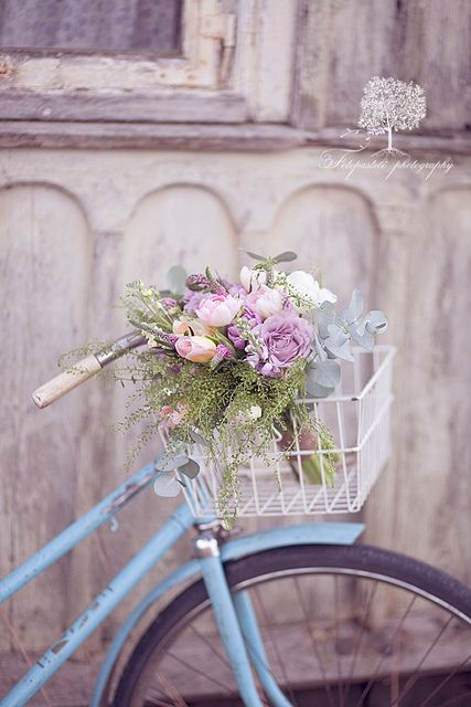 pretty blue bike with flowers
