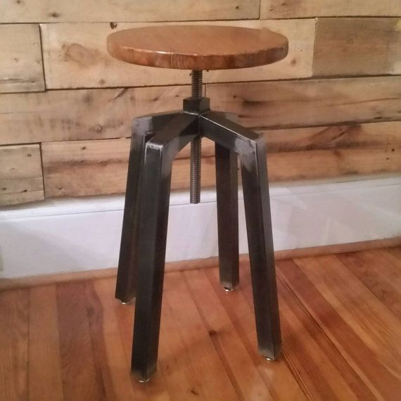 Made from 1.5 square tube cut and welded by hand with a 15 stained wooden height adjustable seat. Adjustment range 23-35.  Levelers at each leg allow this stool to sit flat on any floor. Metal is clear coated to resist corrosion. Wood seat is purposely cut by hand with a scroll saw and not perfectly round. There is uniqueness and personality to each one as a result.  Made to order, takes about a week to ship. Can stain the seat a custom color, just message me what youd like.  Like all my…