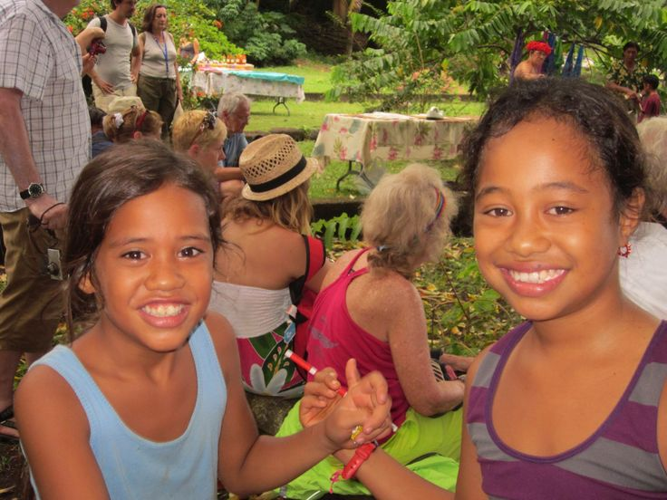 Annie gave these adorable little girls Canadian pencils, and they gave her a hibiscus flowers to put in her hair. #Tahiti #flowers #sunshine