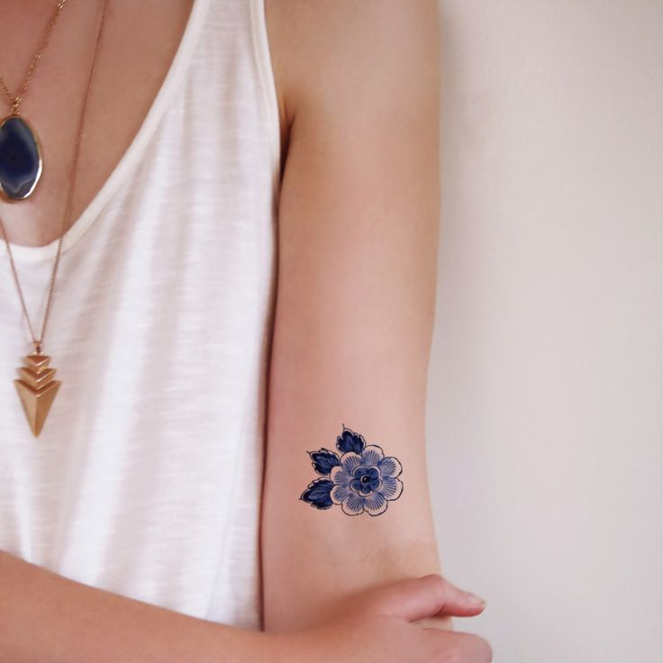 Small Delft Blue flower tattoo from Tattoorary
