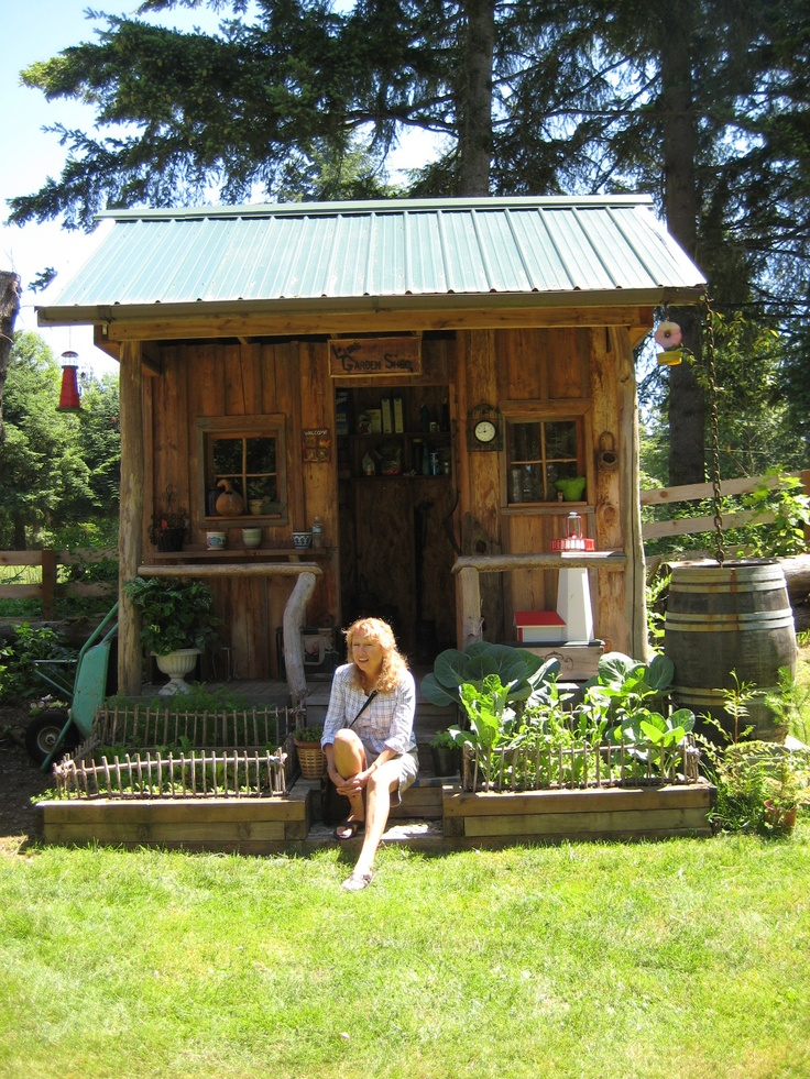Becky Sitting In Front Of A Cute Garden Shed On One Of Our
