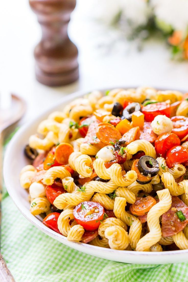 This post may contain affiliate links. Using these links, I earn a small commission at no additional cost to you! Antipasti Pasta Salad is loaded with veggies, cheeses, herbs, and meats and coated in