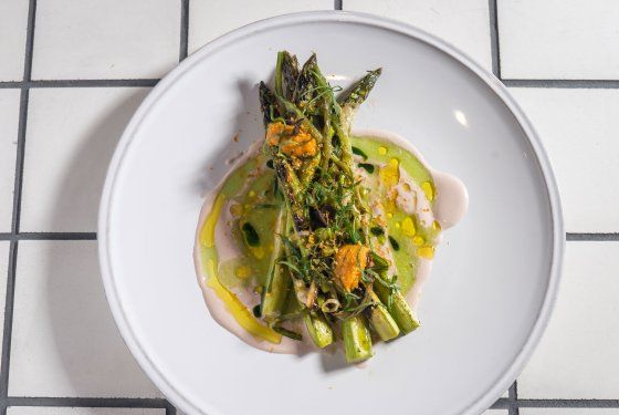 Grilled green asparagus, dried sea urchin, sorrel, and walnuts at Lupulo. Photo: Paul Wagtouicz