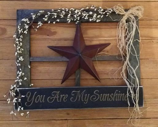 This prim wooden window is handmade in our workshop! It measures 20 x 16 and is decorated with prim berry garland, raffia, large metal star