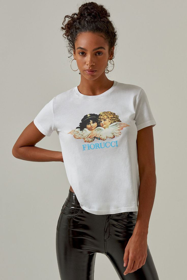 Fiorucci Angels Classic Tee. Sweet. Chic. A classic-fit T-shirt featuring the iconic Fiorucci angel motif, as seen on the walls of the Soho store.