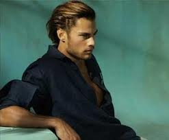 Trend for hairstyles for Men in 2013 is longer hair, pulled off the face, slicked back with gel to create natural waves.