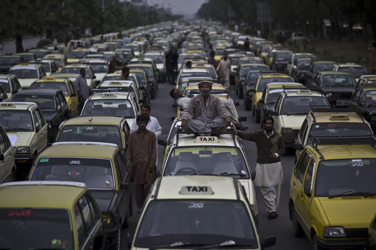 Pakistan daily life -- Pakistani taxi drivers block a main road with their vehicles, during a protest near the parliament in Islamabad, Pakistan, Wednesday, Nov. 6, 2013. The drivers were protesting against the Pakistani traffic police. (AP Photo/Muhammed Muheisen)