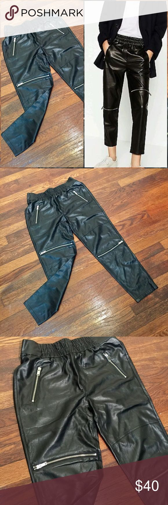 "Zara Premium Collection Faux Leather Jogger Pant S Versatile pair of black faux leather jogger pants from the Zara Premium Denim Collection with zip details. Crop cut, 25"" inseam. Elastic waistline, material is stretchy! Fit like a thick pair of leggings. Size S, worn once, like new condition. Zara Pants Track Pants & Joggers"