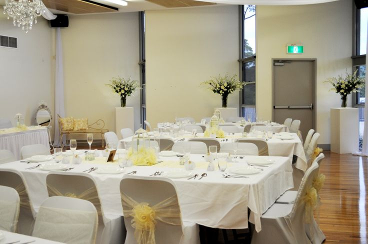 Reception setup we styled & decorated during daylight hours, ready for the night's celebrations to begin. We used our light boxes along the far wall to enhance the style of the function room shape & to give elegance to the room.