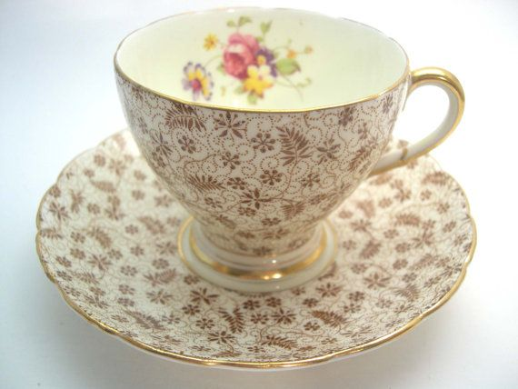 Rare tea cup and saucer made by Foley, England The backstamp date this set to 1930s The tea cup is 2 5/8 high and the saucer is 5 1/2 diameter The rims, handle and the base are gilt. Very good condition, no chips, no hairline and no gold loss and both pieces ping nicely.