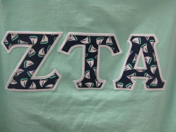 island reef mint green shirt with navy white mint With double stitched greek letters