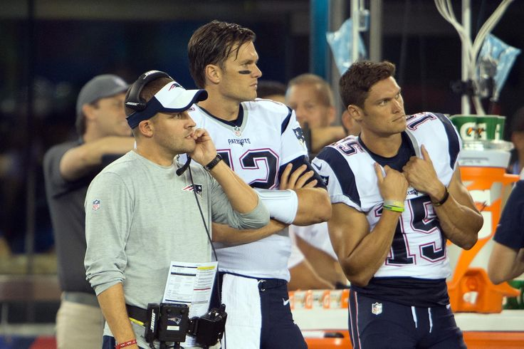 Sep 1, 2016; East Rutherford, NJ, USA; New England Patriots offensive coordinator Josh McDanials looks on with New England Patriots quarterback Tom Brady (12) and New England Patriots wide receiver Chris Hogan (15) in the second half at MetLife Stadium. The New York Giants defeated the New England Patriots 17-9.  (2180×1453)