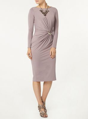 Luxe: Porcini long sleeved dress with a silver bar waist detail.