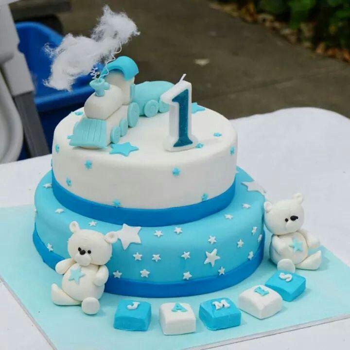 A traintastic 1st Birthday cake with handmade figurines.