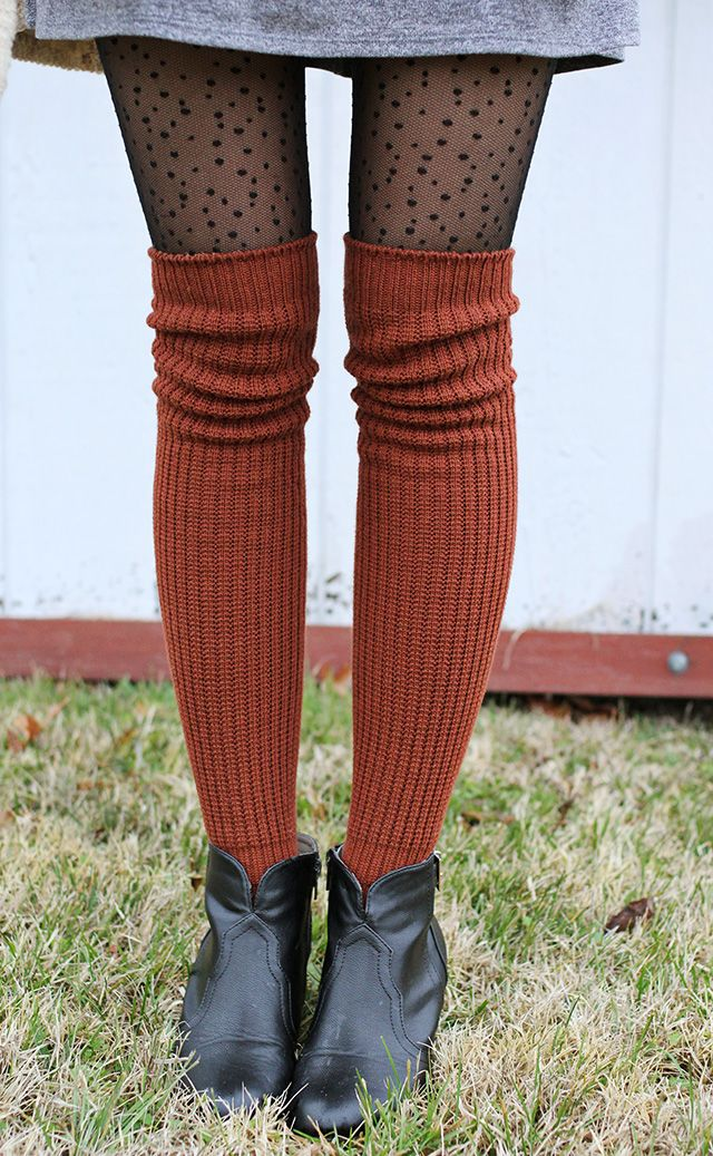 Beautiful burnt-orange knee-high socks atop tights for the fall and winter.