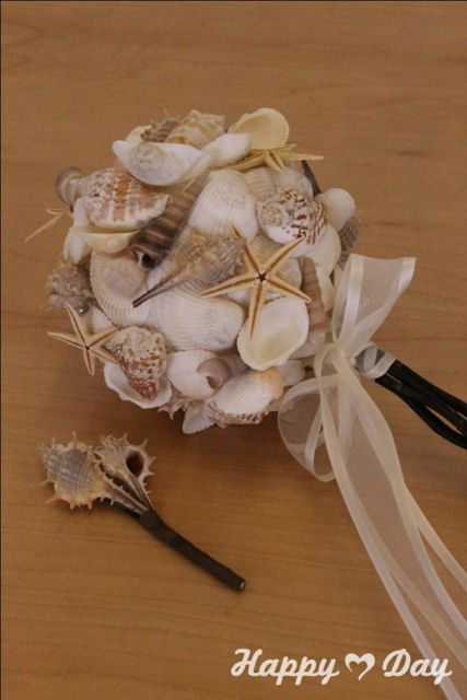 Seashell wedding bouquet and boutonniere by Happy Day