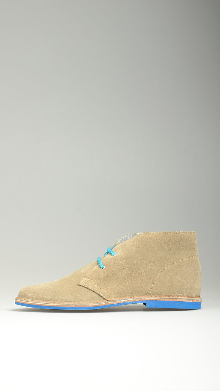Contrast blue rubber sole embellished beige suede lace-ups desert boots featuring contrast azure cotton laces, desert boots manufacturing process, antioxidant eyelets, raw edge stitching, polka-dot embellished lining, 100% high quality suede and split grain leather.
