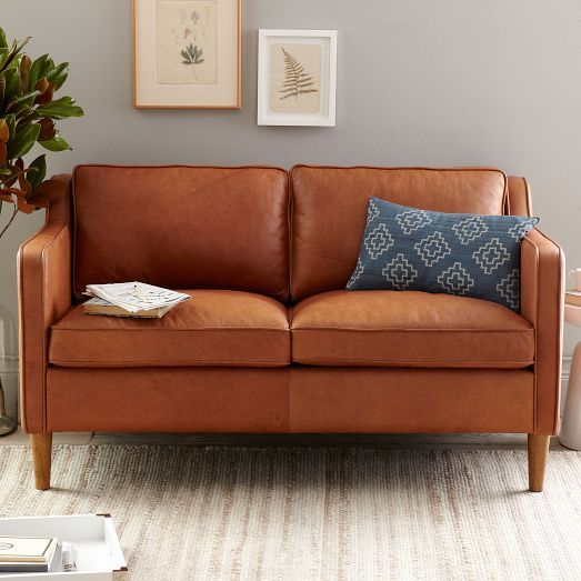 NEW! Inspired by 1950s furniture silhouettes, the Hamilton Loveseat feels as luxurious as it looks. Perched on solid poplar wood legs, it's covered in premium top-grain leather that only gets richer and more comfortable over time.