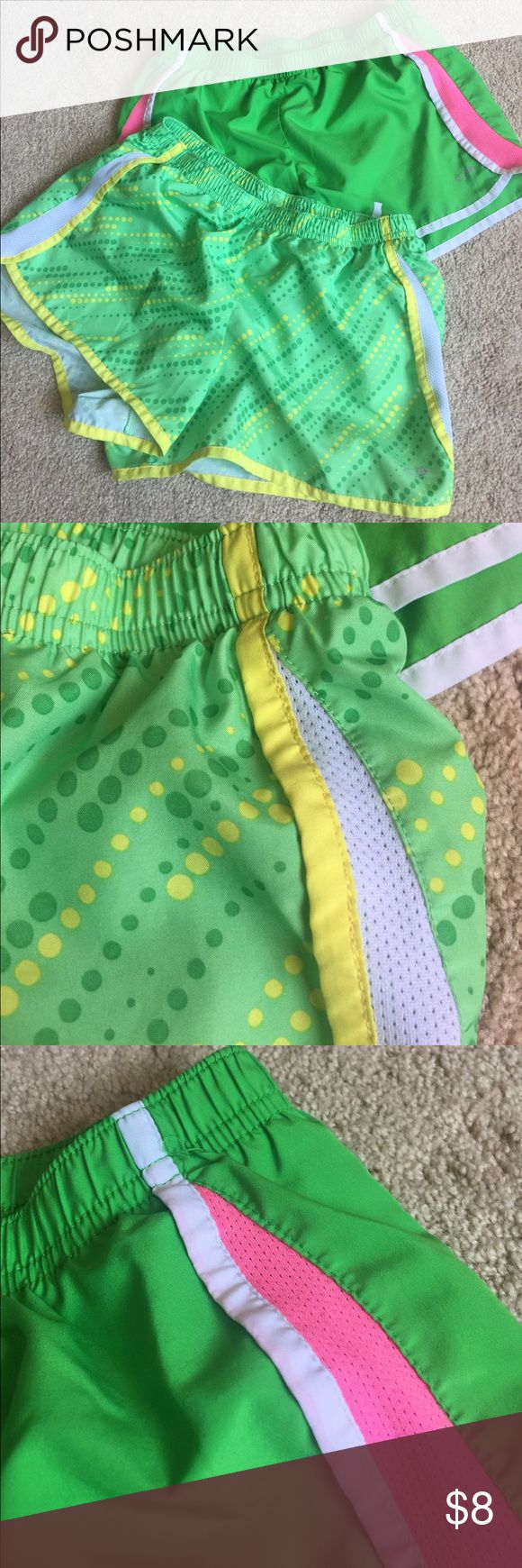 Bundle of 2 pairs green C9 by Champion shorts Two pairs of C9 by Champion running shorts in size Girls XL (14/16). Both in green, one with yellow and dark green dots, white breathable sides, and yellow trim. Second with pink breathable sides and white trim. Price is for the bundle of two pairs! In excellent pre-owned condition.  ***BUNDLE with another item in my closet and pay just ONE shipping fee and save 10% too!!*** Champion Bottoms Shorts