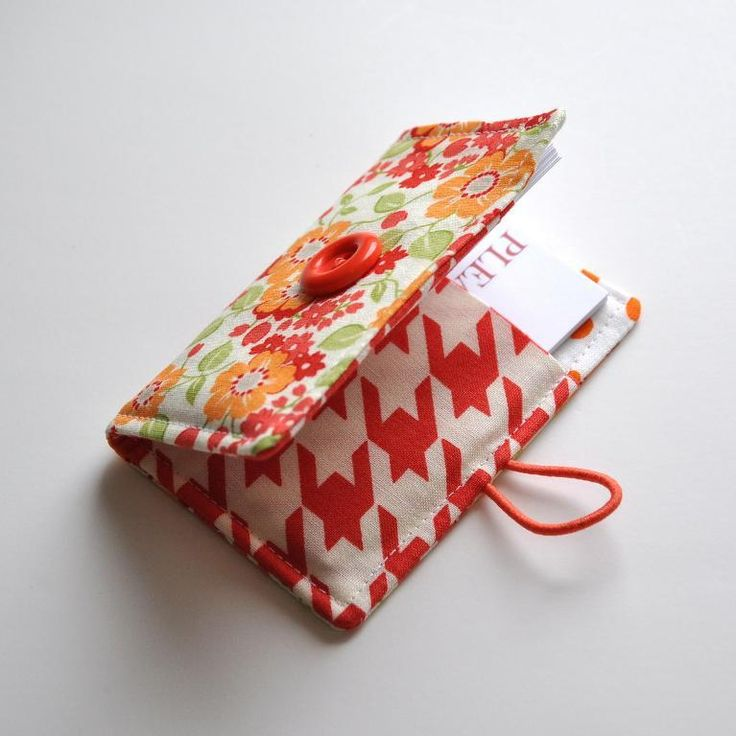 If you have business cards, then you need a business card holder. This one closes with a button and elastic loop. You could also whip one up to hold a gift card.
