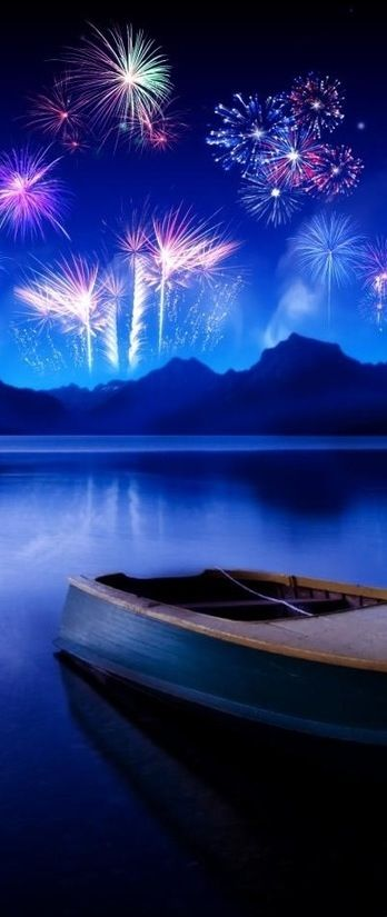 Fireworks across a clear blue sky. This is definitely photoshopped, but I don't…
