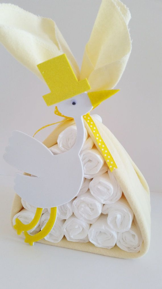 The stork is about to make a special delivery! Give the new mom a one of a kind baby shower gift with this stork bundle! It makes a great gender neutral center piece for any baby shower. This stork bundle that I make starts with 15 usable, high quality diapers wrapped in a soft yellow receiving blanket. It is finished off with coordinating ribbon and an adorable stork traced from a pattern that I made! All diaper creations that I make are packaged meticulously. It can be sent to you or…