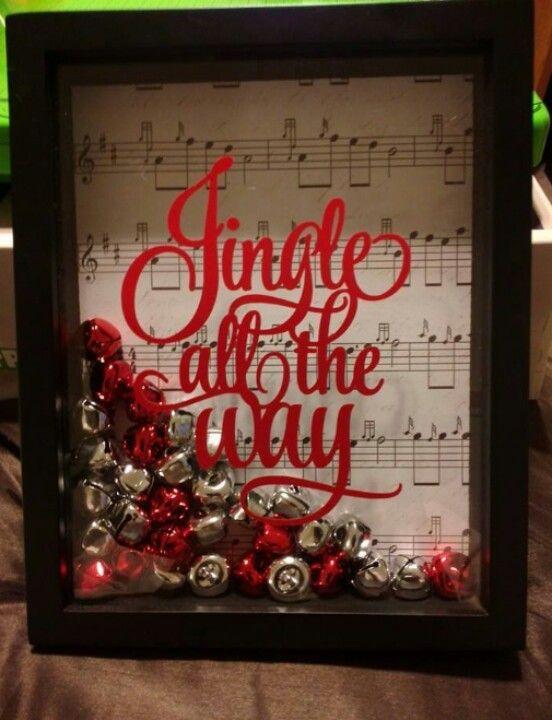 """Jingle all the way"" shadow box w music sheet as back drop."