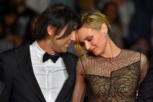 German director Fatih Akin (L) and German actress Diane Kruger pose as they arrive on May 26, 2017 for the screening of the film 'In the Fade' (Aus dem Nichts) at the 70th edition of the Cannes Film Festival in Cannes, southern France. / AFP PHOTO / LOIC VENANCELOIC VENANCE/AFP/Getty Images