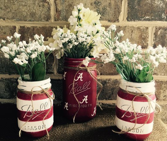 CUSTOM MADE  University of Alabama Roll Tide Crimson Tide mason jar vase set set of 3  2 SMALL CRIMSON AND WHITE STRIPED AND 1 QUART CRIMSON WITH WHITE LETTERSE. ALL HAND PAINTED WITH CHALK PAINT, SEALED WITH WAX AND DECORATED WITH TWINE BOW. FLOWERS ARE NOT INCLUDED  JARS ARE NOT DISWASHER SAFE. CLEAN OUTSIDE WITH A DAMP CLOTH. THE INSIDE IS PAINT FREE SO YOU CAN FILL YOU SET WITHOUT FEAR OF DAMAGING THE DESIGN!  ships within 24 hours