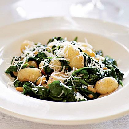Brown Butter Gnocchi with Spinach and Pine Nuts  Pair pasta-like potato gnocchi with wilted spinach for a light and flavorful dish in minutes.