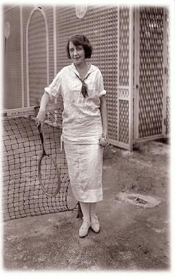 A c. 1920 woman sporting a tennis blouse and skirt.