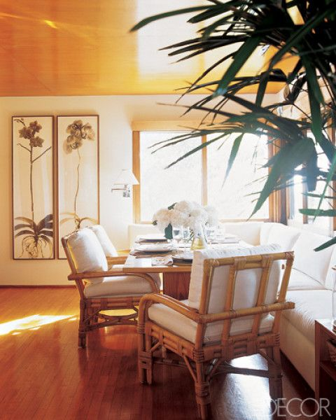 Cane furniture and sectional in dining space of Ralph Lauren's Montauk Beach home