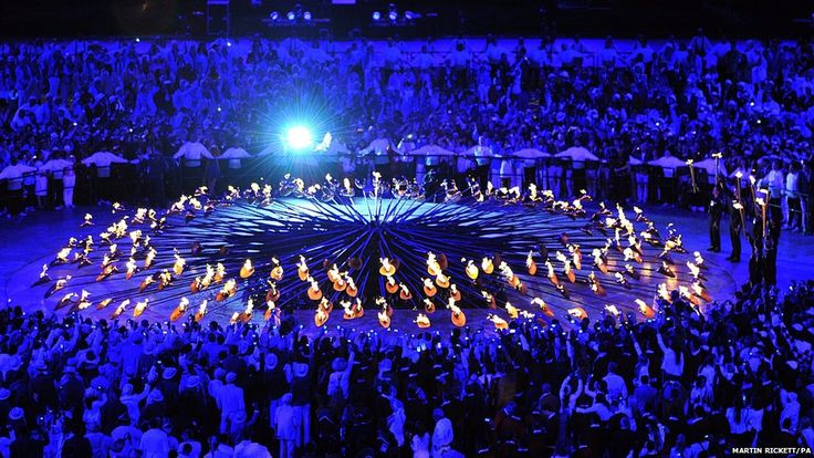 A group of seven young athletes light the Olympic Cauldron during the London Olympic Games 2012 Opening Ceremony