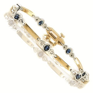 Diamond Jewellers :: This beautiful bracelet has 4 X 3 mm/7 Oval Sapphire weighing approximately 1 1/2Cts. and 14 diamond weighing approximately  1/4cts set in 14K TT. Due to Gold price change frequently Call to check availabilty & Current Prices . Available in WG and Two ton