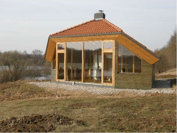 the eco cocon solar house, made with strawbale in lithuania.