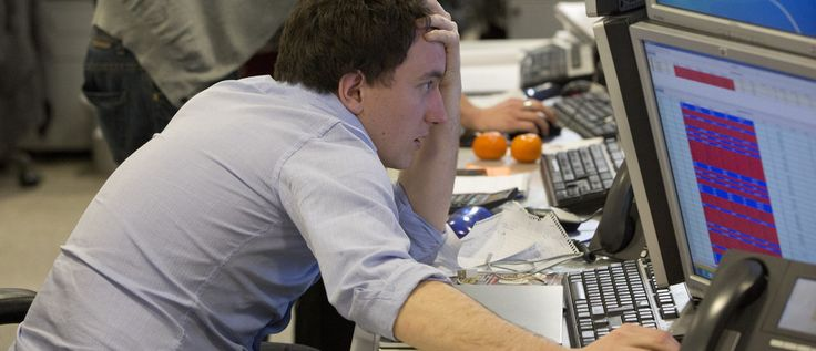 A trader looks at his screen on the IG Group trading floor in London March 18, 2013. The surprise decision by euro zone leaders to part-fund a bailout of Cyprus by taxing bank deposits sent shockwaves through financial markets on Monday, with shares and the bonds of struggling euro zone governments tumbling.    REUTERS/Neil Hall (BRITAIN - Tags: BUSINESS POLITICS TPX IMAGES OF THE DAY) - RTR3F5E7