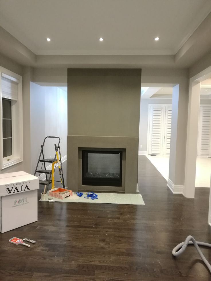 Popular Benjamin Moore Gray--Chelsea Gray accent wall and fire place, it is painted by Mi Painting & Wallpaper https://www.mipaintingwallpaper.com