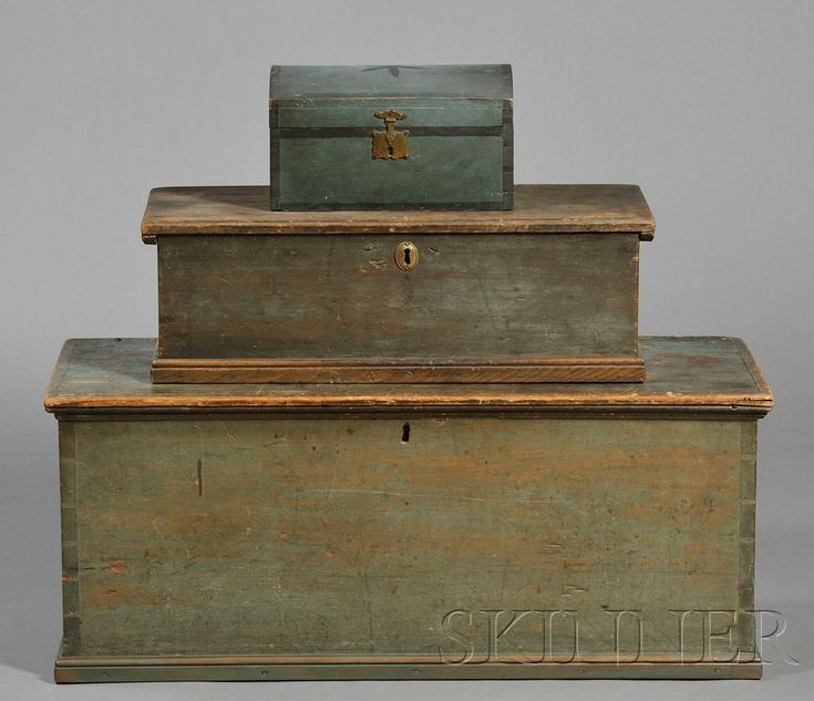 Three Painted Boxes, New England, 18th and early 19th centuries, the largest of dovetail construction, the smallest box with dome-top decorated with a six-point blossom, wd. to 35, ht. together 30 in.     Provenance: Blossom-decorated box from Pam Boynton, 1977.