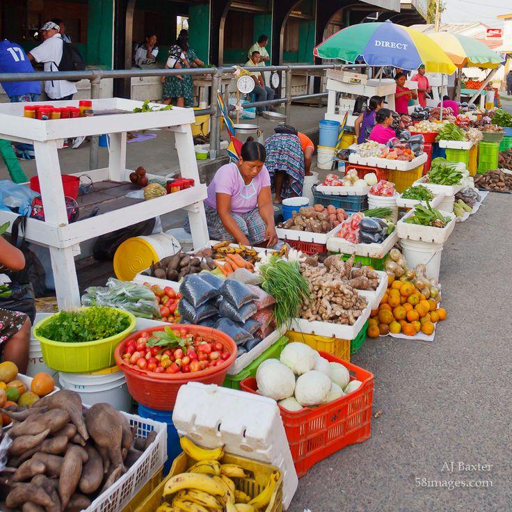 Colourful image of a market vendor in the street market of Punta Gorda, Belize by AJ Baxter