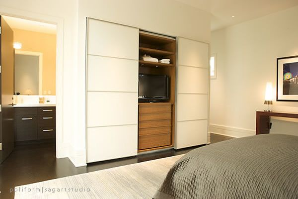 built in robes with sliding doors to cover tv times!