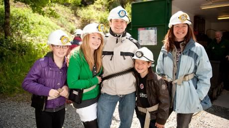 Family group kitted up for underground tour http://www.nationaltrust.org.uk/dolaucothi-gold-mines/