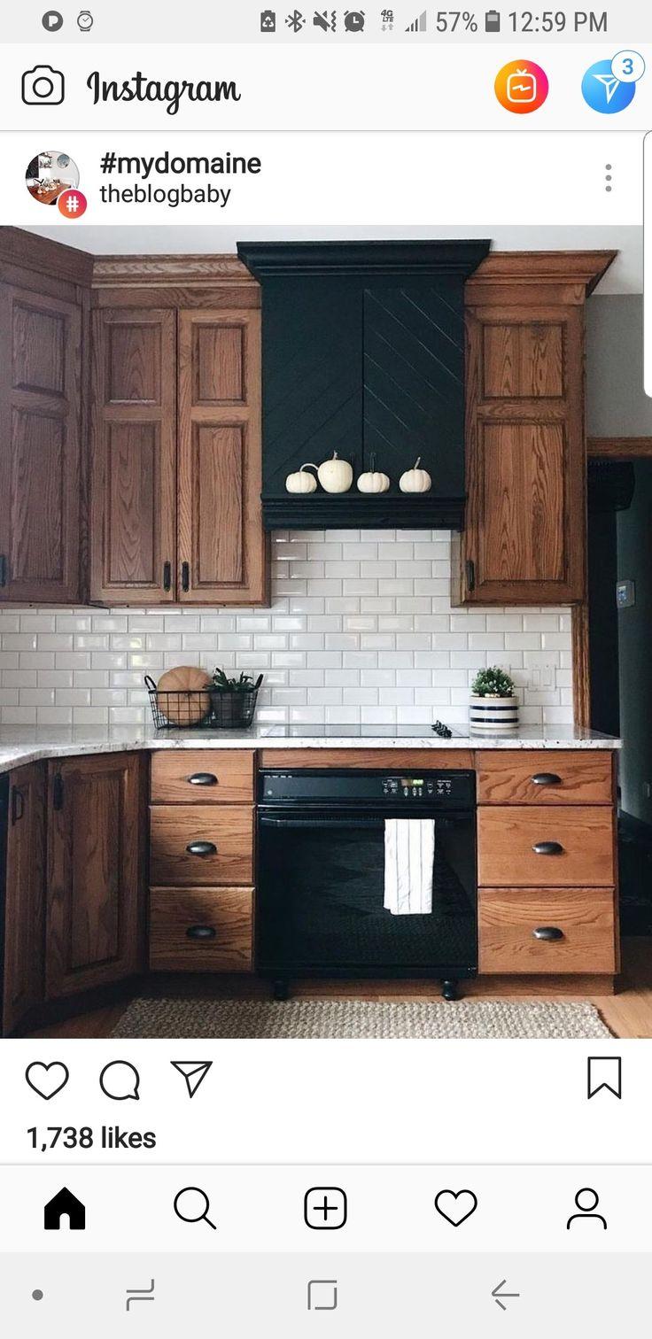 Mid tone oak in kitchen. Black hardware and white