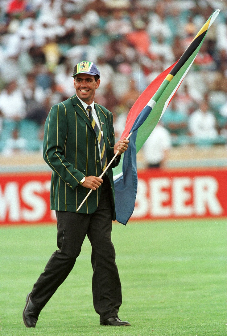 Hansie Cronje supports South Africa at a football match