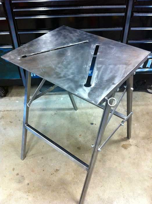 Folding welding table