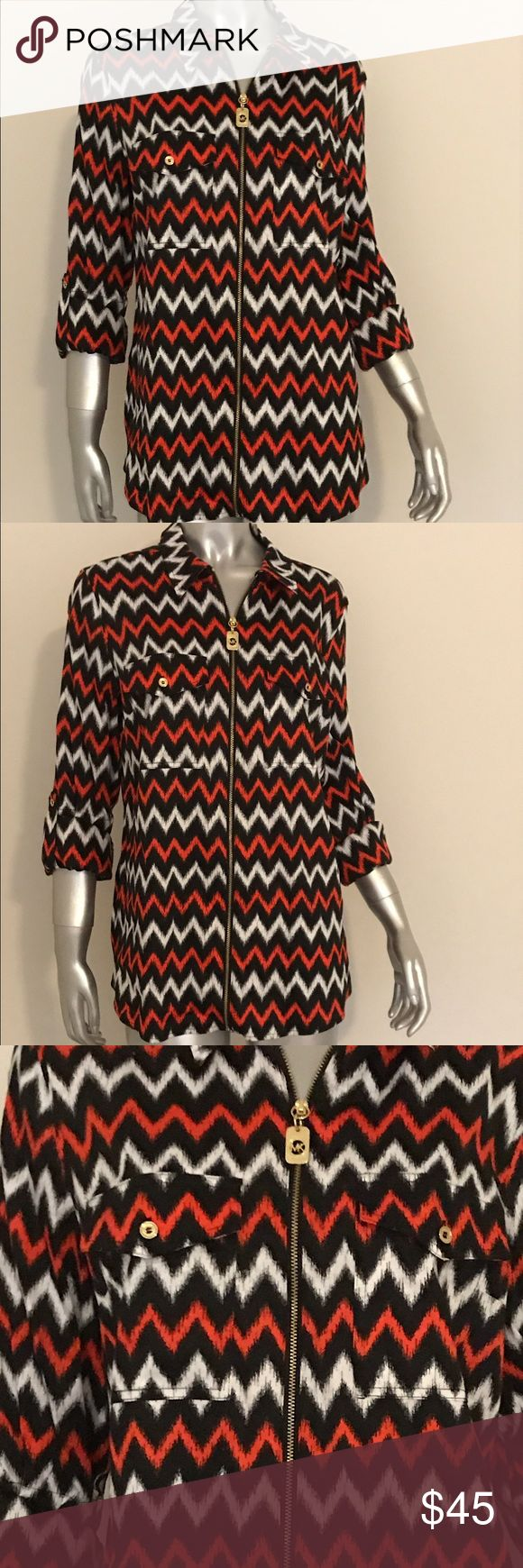 Michael Kors Chevron Shirt NWT Stunning Michael Kors Chevron print top. Gold zipper with Michael Kors Logo down front. Can be worn 3/4 sleeve or long sleeve. New with tags $130. Michael Kors Tops Blouses