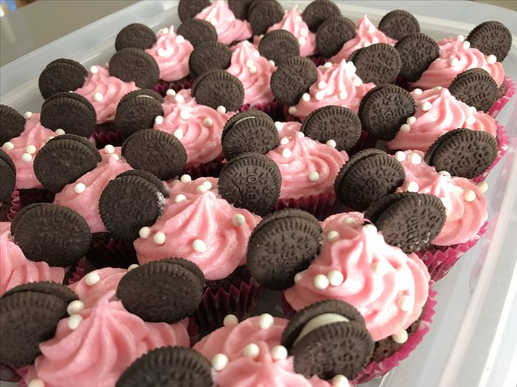 Minnie Mouse! Chocolate cupcakes with raspberry buttercream and Oreo ears