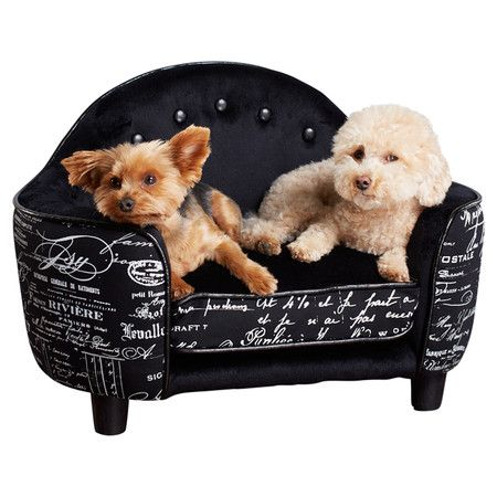 Let your furry friend lounge comfortably on this stylish sofa-inspired pet bed, featuring a wood frame and delightful French script upholstery.