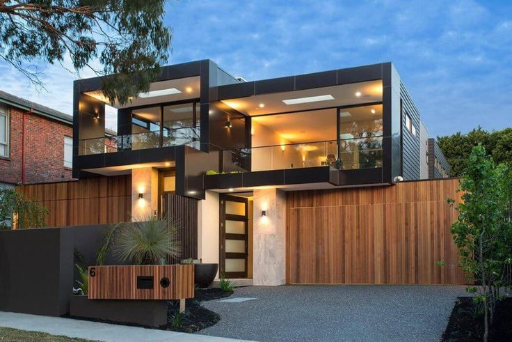 This contemporary two-storey house located in Black Rock, Victoria, Australia, was built in 2015 by Madden Building Group.